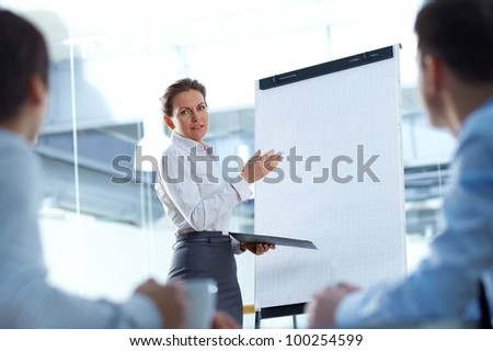 Business woman presenting a new project to her partners