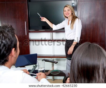 Business woman presenting something in a meeting at the office