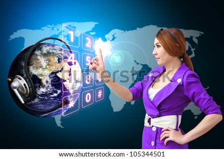 Business woman press on dial pad number on digital world : Elements of this image furnished by NASA