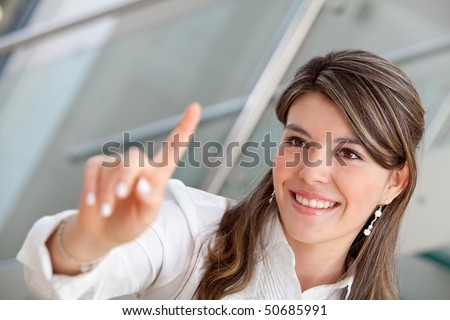 Business woman pressing an imaginary button and smiling