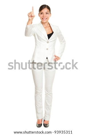 Business woman pressing invisible button with index finger standing in full length isolated on white background. Beautiful young happy smiling multi-cultural Asian / Caucasian businesswoman.