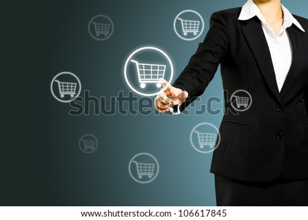 Business woman pressing shopping cart icon