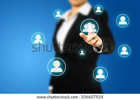 Business woman pressing Social network icon