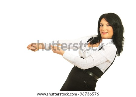 Business woman pulling something imaginary isolated on white background