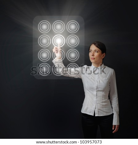 business woman pushing button on virtual dial panel on black background