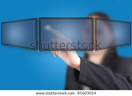 Business woman pushing icon on the tablet screen interface.