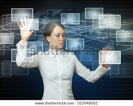business woman pushing virtual icons in web interface with her hands over blue