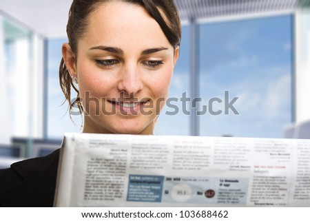 Business woman reading a newspaper