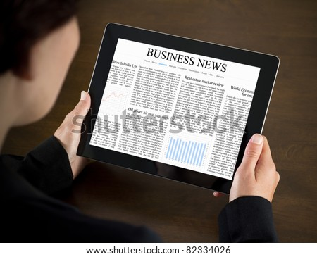 Business woman reading business news on the touch screen device.