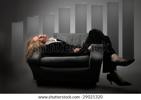 business woman relaxing on armchair against graph chart showing company's growth and success