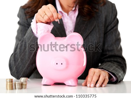 Business woman saving money in a piggybank - isolated
