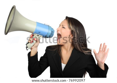 Business woman screaming with a megaphone