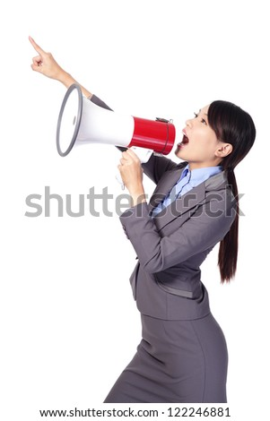 Business woman screaming with a megaphone and finger point to empty copy space isolated on white background, model is a asian beauty