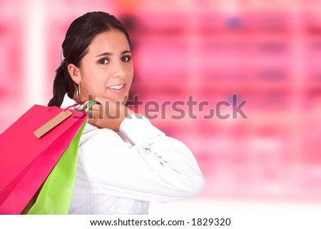 business woman shopping - pink background - stock photo