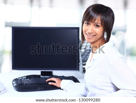 Business woman showing blank display