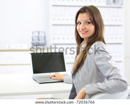 business woman showing blank laptop