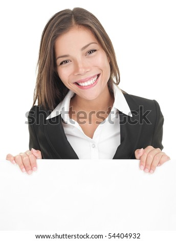Business woman showing blank sign board. Asian busineeswoman in suit presenting billboard isolated on white background. Young Asian / Caucasian female model.