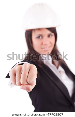 Business woman showing closed hand - focus on hand
