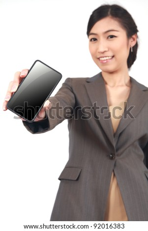 Business Woman Showing display of touch mobile cell phone (Focus on the hand and phone)