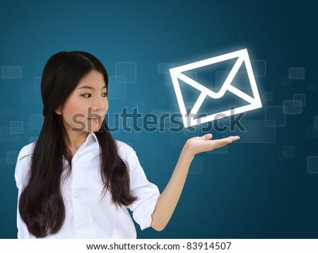 Business woman showing e-mail symbol