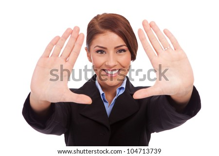 Business woman showing framing hand gesture - isolated on white