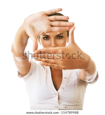 business woman showing framing hand gesture on white background