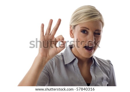 Business woman showing okay sign isolated over a white background