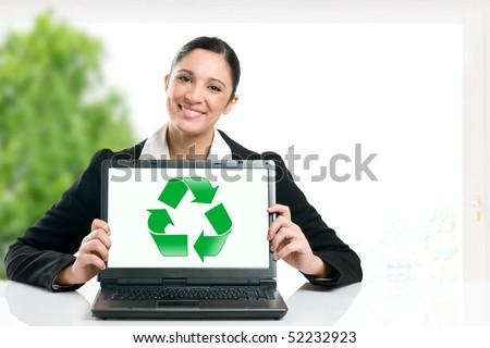 Business woman showing recycling green symbol in her laptop monitor, copy space for your text - stock photo