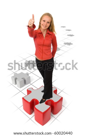 Business woman showing thumbs-up on a red puzzle piece