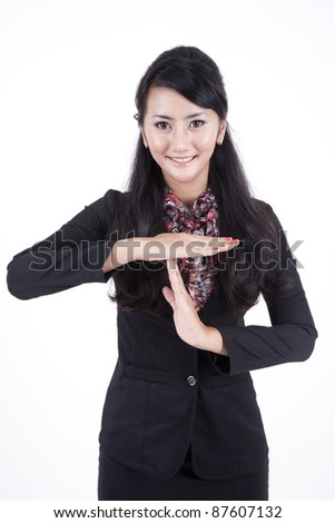Business woman showing time out geture hand isolated on white background