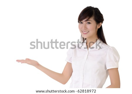 Business woman showing with hand on white space.