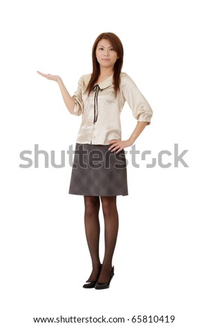 Business woman showing with hand on white space isolated over white.