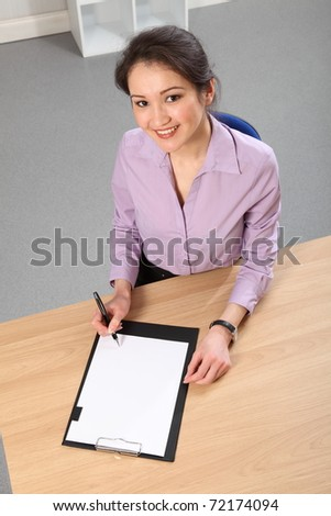 Business woman sitting at desk