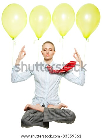 business woman sitting in lotus pose and flying on air balloons, meditating, with flying tie