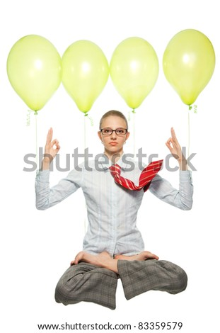 business woman sitting in lotus yoga pose and flying on