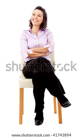 business woman sitting on a chair isolated over a white background