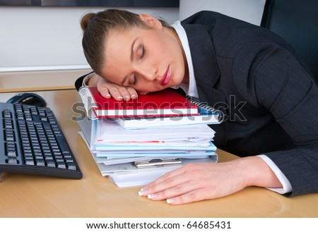 business woman sleeping at office desk