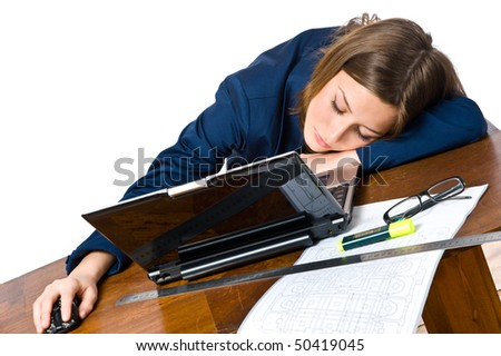 Business woman sleeping on the laptop at her desk