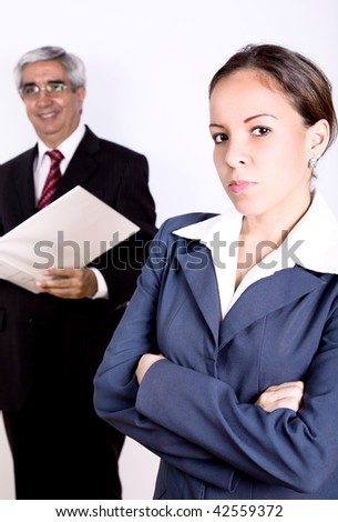 Business woman smiling and looking at the camera. People behind