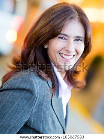 Business woman smiling and looking very happy