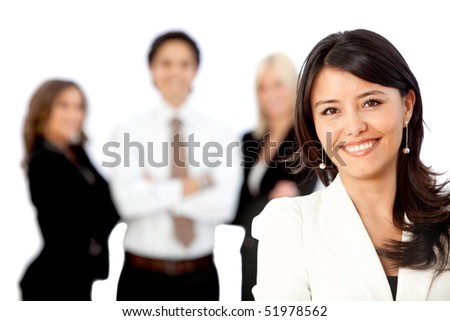 Business woman smiling with her team behind her - isolated over white