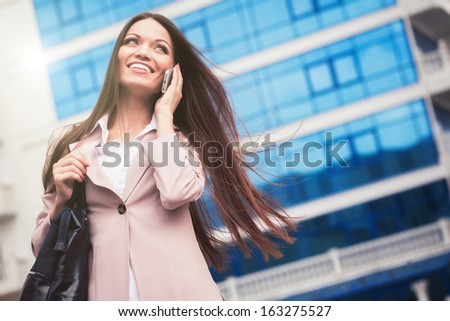 Business woman speaking cellphone on the street stock photo