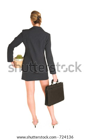 Business woman standing, holding suitcase and potplant, - full length