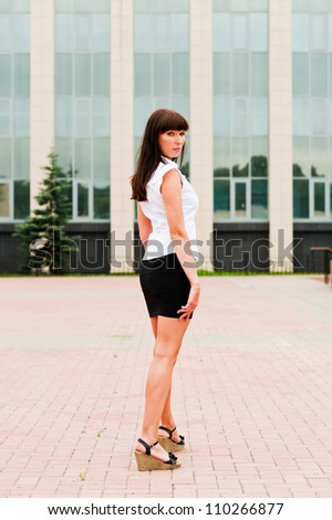 business woman standing in a half-turn