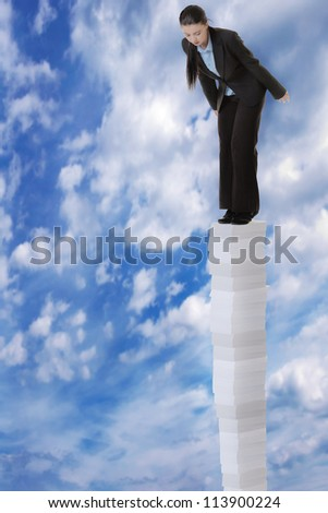 business woman standing on a very large stack of paper work, going high up into a sky  and she looking down at the earth below her