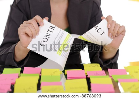 Business woman surrounded by sticky notes