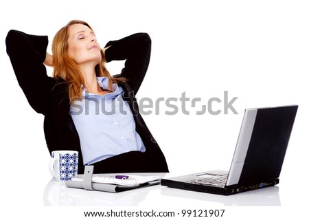 Business woman taking a break and relaxing with her hands behind her head and sitting on an office chair
