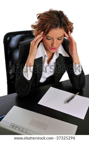 Business woman taking a break to de-stress by massaging the temples of her forehead at her desk.
