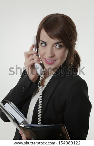 business woman taking on the phone looking happy