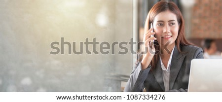 Business woman talking on the phone and labtop in coffee shop. Working concept.